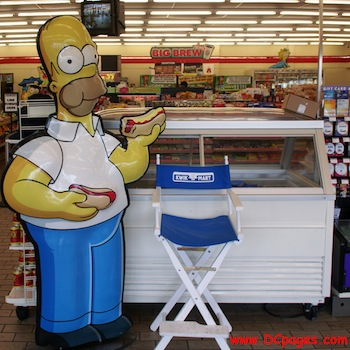 Homer Simpson at a Kwikee Mart with a Hot Dog