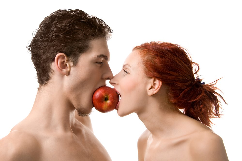 Man and woman sharing an apple