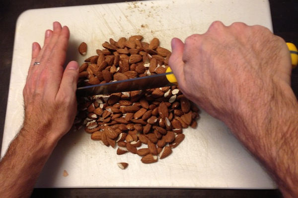 dad's raw energy ball - chopping almonds
